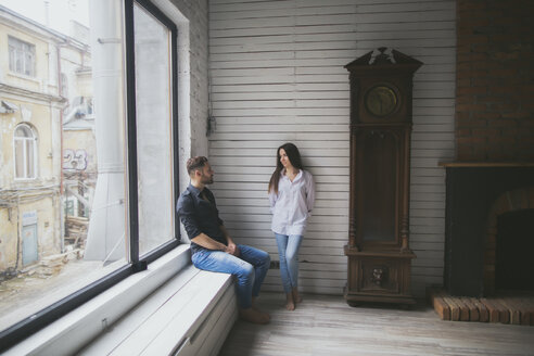 Caucasian couple hanging out near window - BLEF00547