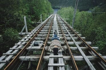 Caucasian man laying on train tracks - BLEF00550
