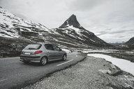 Car driving on road in winter landscape - BLEF00559