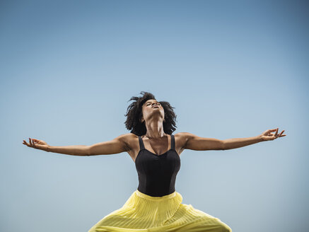 Black woman dancing with arms outstretched - BLEF00652