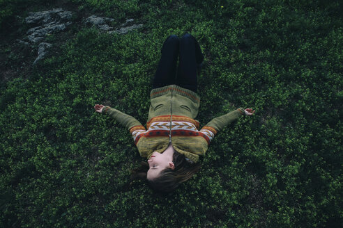 Caucasian woman laying in grass - BLEF00742