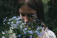 Caucasian woman smelling flowers - BLEF00745
