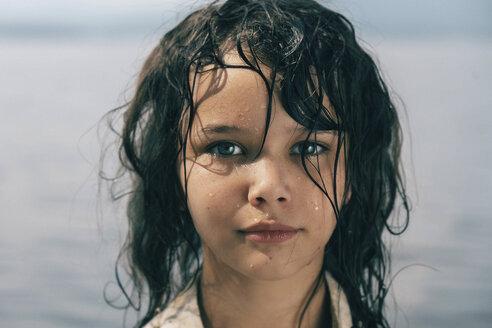 Caucasian girl with wet hair near lake - BLEF00760