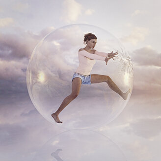 Woman escaping from cracking glass sphere - BLEF00829