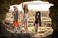 Portrait of Caucasian boy and girls hiking on rocks at beach - BLEF00865