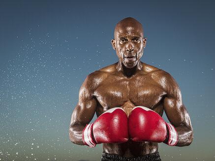 Water splashing on confident black boxer outdoors - BLEF01024