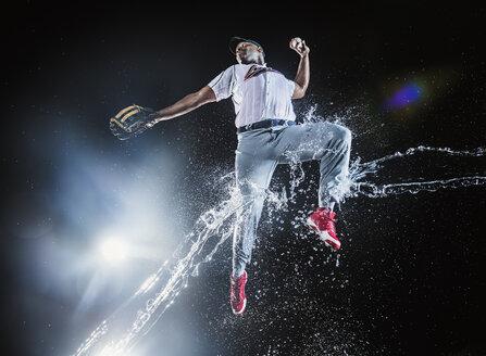Water splashing on jumping black baseball player - BLEF01036