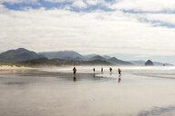 Distant people running on beach - BLEF01057