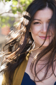 Wind blowing hair of Caucasian woman - BLEF01111