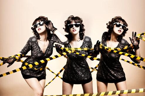 Caucasian women tangled in caution tape - BLEF01123