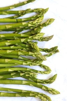 Row of green asparagus on white background - JTF01228