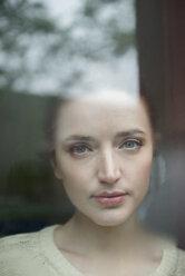 Serious Caucasian woman behind foggy window - BLEF01174