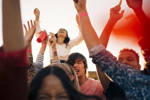 Friends enjoying at music festival during summer - MASF12170