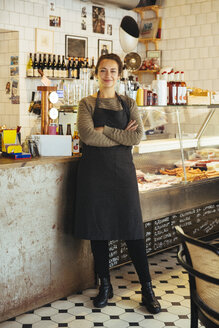 Portrait of confident young female owner standing with arms crossed at cafe - MASF12260