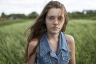 Wind blowing hair of Caucasian woman in field - BLEF01337