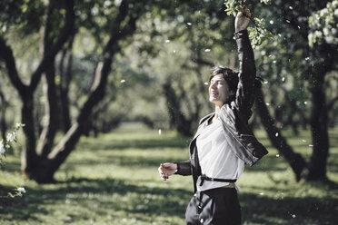Happy woman enjoying blossoming season - EYAF00187