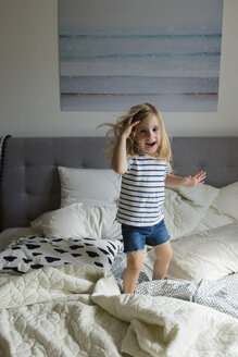 Caucasian girl jumping on bed - BLEF01809