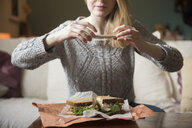 Woman photographing sandwich with cell phone - BLEF01824