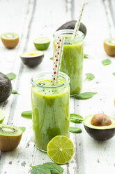 Two glasses of green smoothie with avocado, spinach, kiwi and lime - LVF07995