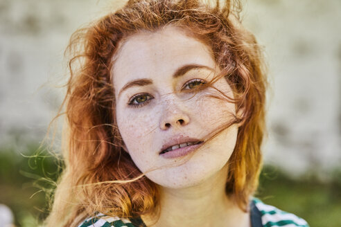 Portrait of redheaded young woman with freckles - FMKF05665