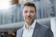 Portrait of confident businessman at the airport - DIGF06840