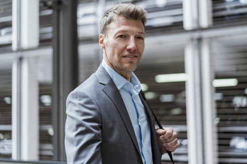 Portrait of businessman at car park - DIGF06897