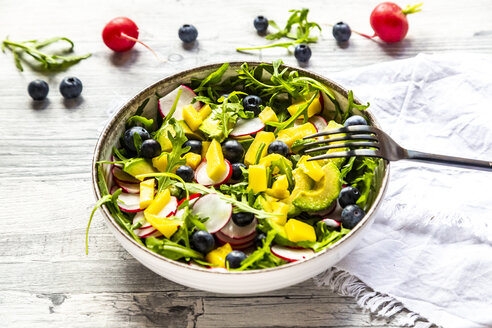 Bowl of rocket salad with mango, avocado, red radishes and blueberries - SARF04247
