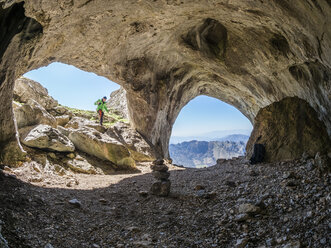Spain, Asturia, Pena Mea, hiker in a cave - LAF02276