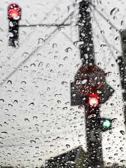 The rain falls on a car windshield at a traffic light. Cluj-Napoca, Romania. - OCMF00443