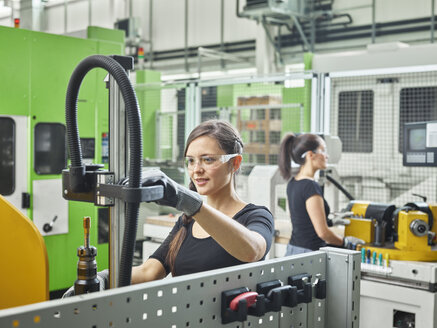 Two women working on machines - CVF01144