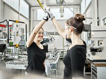 Two women at work, high five - CVF01153