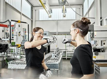 Two women at work, fist bump - CVF01156