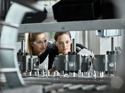 Young women checking production line on a conveyor belt - CVF01162
