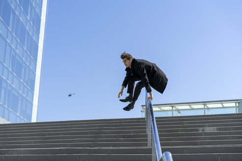 Businessman crossing banister in the city - AFVF02849