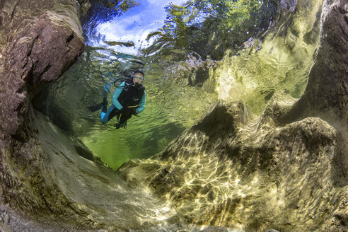 Austria, Salzkammergut, river Weissenbach, female scuba diver in a wild mountain river - YRF00213