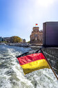 Germany, Berlin, Reichstag and German flag on excursion boat on River Spree - PUF01418
