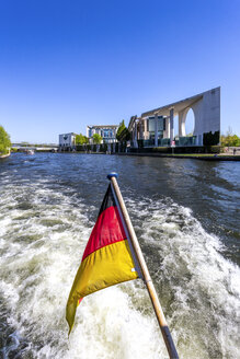 Germany, Berlin, Chancellery and German flag on excursion boat on River Spree - PUF01421