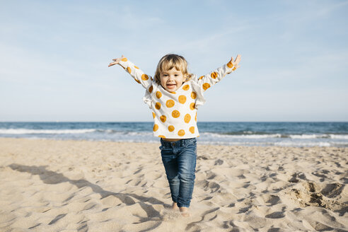 Portrait of happy little girl running on the beach - JRFF03227