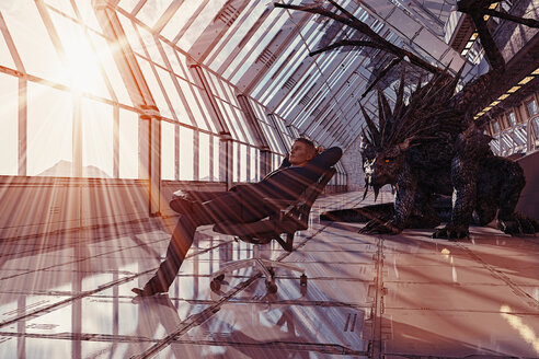 Dragon behind businessman leaning in chair - BLEF02208