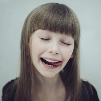 Portrait of Caucasian girl licking lips - BLEF02253