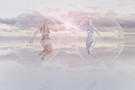 Futuristic women floating in sky in transparent spheres - BLEF02437