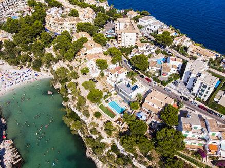 Spain, Balearic Islands, Mallorca, Llucmajor, Aerial view of bay of Cala Pi and beach - AMF06982