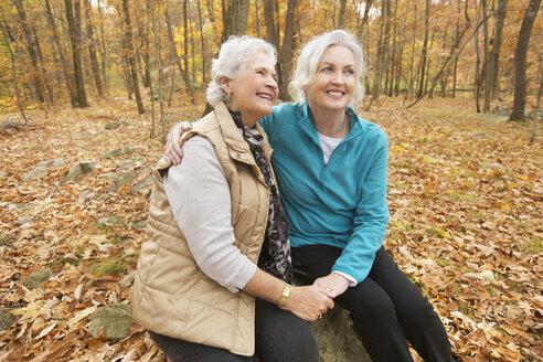Caucasian women hugging outdoors in autumn - BLEF02706