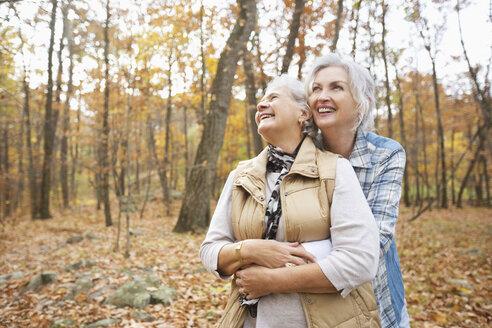 Caucasian women hugging outdoors in autumn - BLEF02718