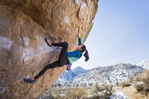 Mixed Race girl climbing rock - BLEF02727