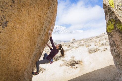 Mixed Race girl climbing rock - BLEF02730