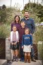 Portrait of smiling family in garden - BLEF02745
