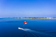 Maldives, South Male Atoll, aerial view of paraglider on the sea at an atoll - AMF06992