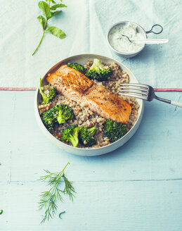 Fried salmon with buckwheat pilaf and broccoli in a bowl - PPXF00193