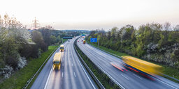 Germany, Baden-Wuerttemberg, traffic on Autobahn A8 at sunset - WDF05260